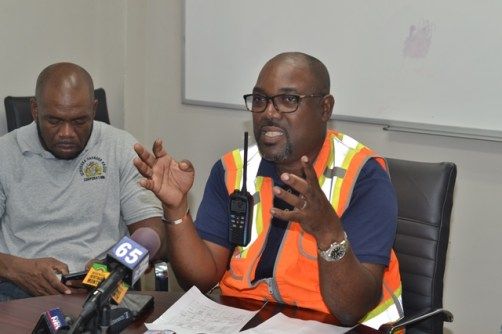 [In the photo, right] General Manager of the Demerara Harbour Bridge Corporation, Rawlston Adams.