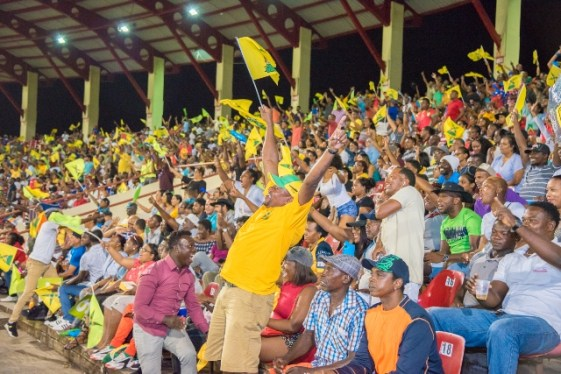 Fans celebrating the Guyana Amazon Warriors victory over the St. Lucia Zouks at the Guyana National Stadium.