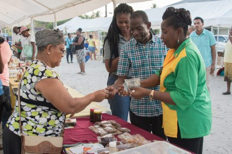 Minister within the Ministry of Agriculture, Hon. Valerie Adams-Yearwood makes a stop during her rounds at the exhibition.
