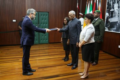 His Excellency, President David Granger receiving the letter of credence from European Union Ambassador to Guyana, H.E Fernando Cantó in the presence of Minister of Foreign Affairs, Hon. Dr. Karen Cummings