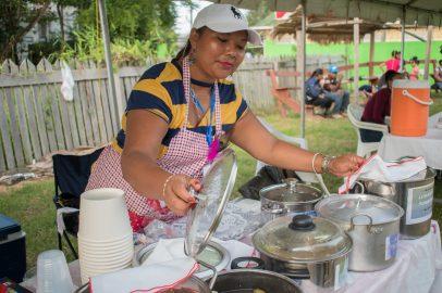 Synieka Jacobs invites patrons to sample her tuma pot