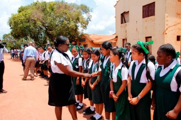 Minister Henry greeting students upon arrival in Lethem