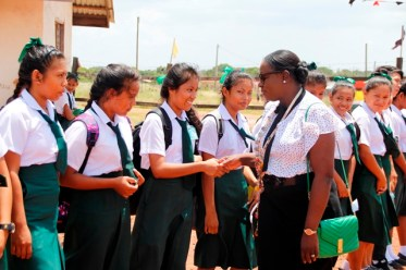 Minister Henry being greeted by students of the St. Ignatius Secondary School upon her arrival at the institution