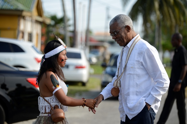 His Excellency, President David Granger is greeted by a member of the Nappi Culture Group.
