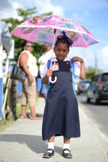 Little Donelle Roberts smiles for the camera as she maker her way to school.