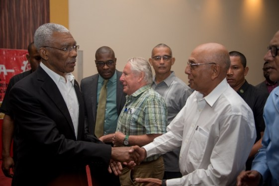 H.E President David Granger greets one of the guests at the GMSA luncheon.
