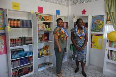 Minister of Education, Hon. Dr. Nicolette Henry and Minister of Public Health, Hon. Volda Lawrence in Kimbia's new Learning Resource Library and ICT Hub.