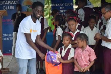 Students of Kimbia Primary receiving school supplies.
