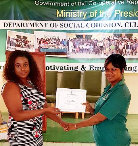 Onanza Haynes, a successful past student of the Kildonan Night School receiving her certificate.