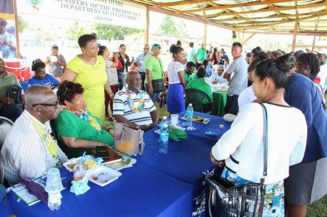 [In the photo, from left] Minister of Citizenship, Hon. Winston Felix, Minister of Social Protection, Hon. Amna Ally, [standing] Minister of Public Health, Hon. Volda Lawrence and Minister within the Ministry of Social Protection, Hon. Keith Scott engaging a resident at the Port Kaituma outreach.