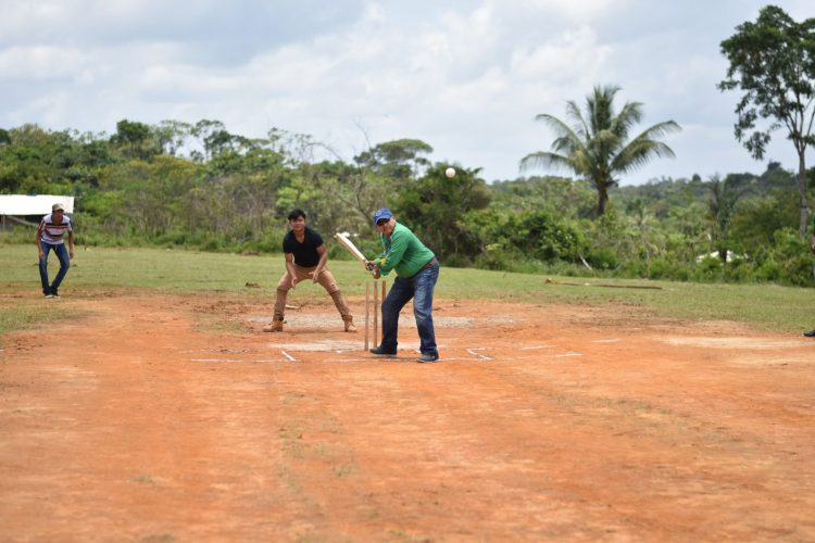 Minister of Indigenous Peoples' Affairs, Hon. Sydney Allicock batting the first ball to kickstart the Cricket competition