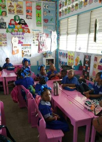 Students of the Watooka Day Primary School, settling in without hiccups in their new classroom.