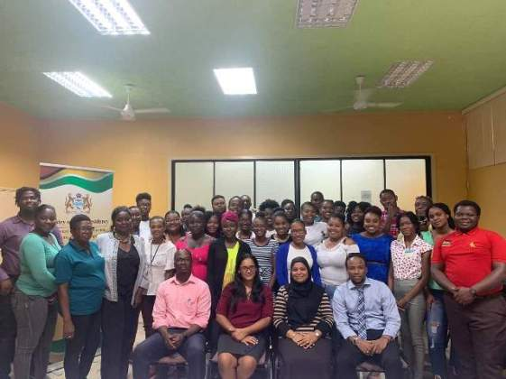 Workshop facilitator Will Campbell (seated extreme left) and Member of Parliament, Jermaine Figueira (seated extreme right) along with the participants of the 2-day nation-building workshop