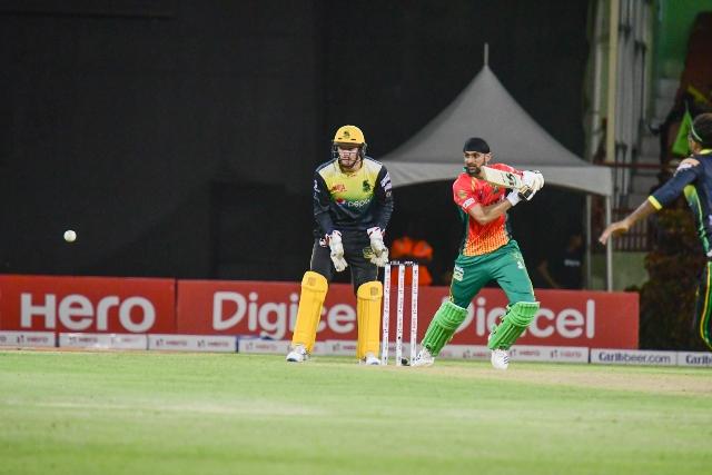Shoaib Malik guiding the ball for a boundary during his unbeaten 73 runs score me.