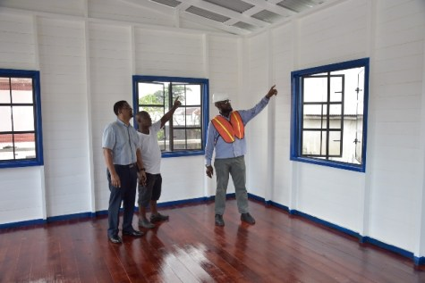 [In the photo, from the left] City Councilors, David Allicock and Eston Bostwick along with M&CC City Engineer Rashid Kellman carrying out inspections on the rehabilitated office to house the City Constabulary in the Albouystown Market.