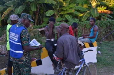 A CDC official engaging residents in Region 5.