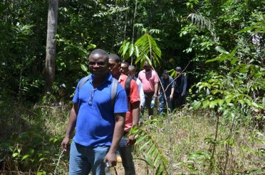 Project Coordinator of the GEA, Mfon Akpan and the team trekking into the area.