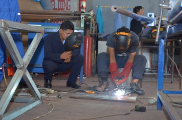 Some of the students attached to the Essequibo Technical Institute in a welding and fabrication class.