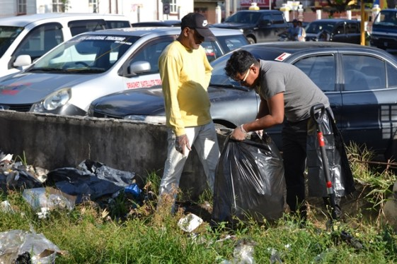 Members of the Muslim Core Groups attached to the Department of Social Cohesion, Culture, Youth and Sport cleaning up the Parliament Sqaure in Brickdam Georgetown.