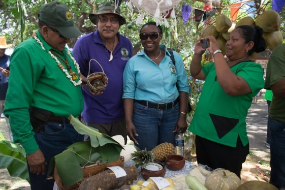 Minister of Indigenous Peoples' Affairs, Hon. Sydney Allicock Ministerial Advisor, Member of Parliament (MP), Hon. Mervyn Williams and Permanent Secretary, Sherie Samantha Fedee' browsing some of the items on sale.