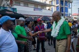 Excellency, President David Granger greeting New Amsterdam residents.