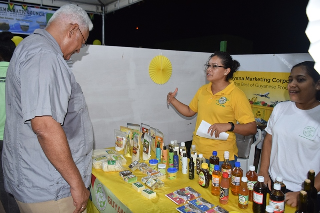 Minister of Agriculture, Hon. Noel Holder visiting one of the booths.