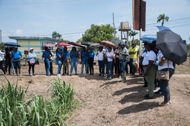 Employees within the ministry's department and agencies during the familiarization tour, at the Uitvlugt Sugar Estate on Tuesday.