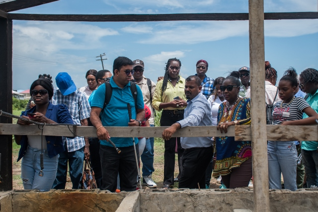Some persons with disabilities visiting a site in the Guyana School of Agriculture where shade house farming is done. Accompanying them is Minister within the ministry of Agriculture, with responsibility for Rural Affairs, Hon. Valerie Adams Yearwood.