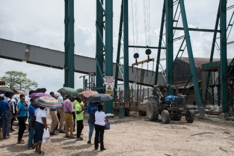 Employees within the ministry's department and agencies look keenly at the operation of cane extraction.