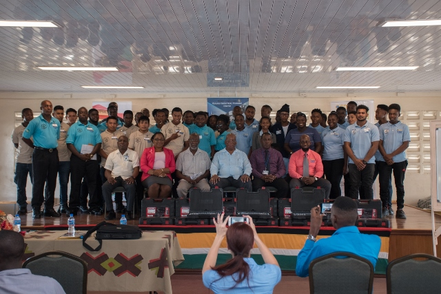 Students of this year's BNTF training programme pose with Finance Minister, Hon. Winston Jordan and other officials at the launching ceremony on Wednesday.