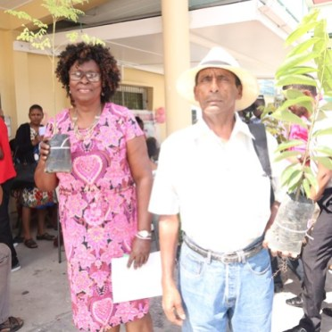 Some of the patients attending the clinic at the Guyana Cancer Institute with their plants.