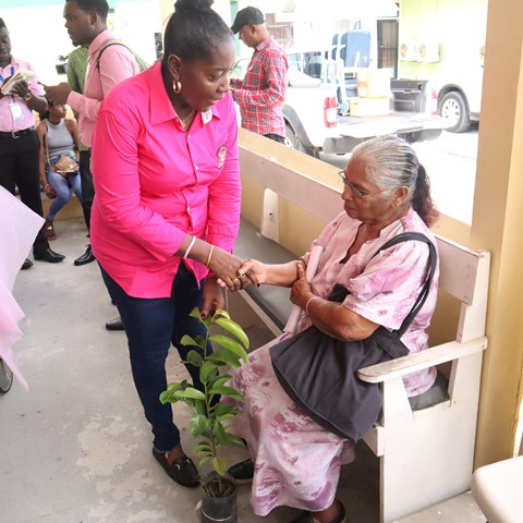 Minister within the Ministry of Agriculture, with responsibility for Rural Affairs, Hon. Valerie Adams-Yearwood presents a patient at the Guyana Cancer Institute with one of the plants.