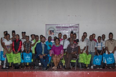 [Seated from left] Denon Lewis, Minister of Public Telecommunications, Hon. Catherine Hughes and Chairman of the Mentorship Scheme, Vincent Alexander, along with the 22 mentees who were inducted today.