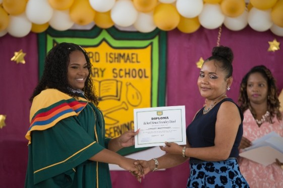 Richard Ishmael Secondary School's graduates receiving their certificates.
