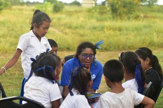Minister Hughes interacts with children of a North Rupununi village