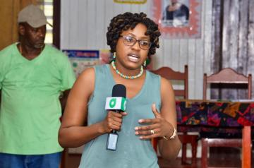 Minister of Public Service, Hon. Tabitha Sarabo-Halley makes a point during her discussions with the residents of Yarakita.