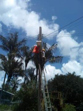 Street lights being installed in Ituni's community roads.