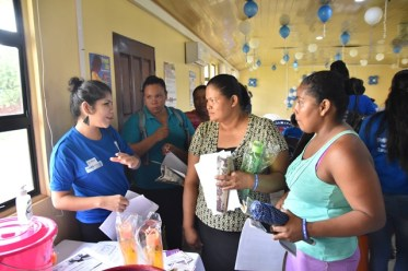 Residents attending the launch to commemorate 'Malaria Day in the Americas', at the Port Kaituma Community Centre, taking advantage of the services offered.