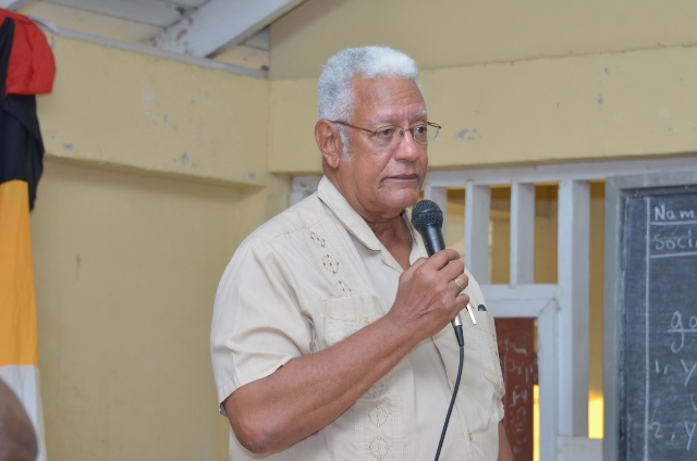 Minister of Agriculture, Hon. Noel Holder, makes a point to the audience.