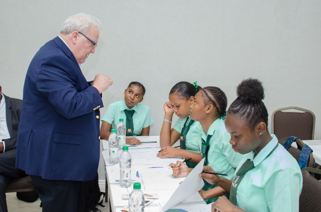 Executive Vice President and Co-founder of JHI Associates Richard Boyce interacts with students of the Kingston Secondary School.
