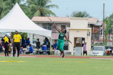 One of the javelin throwers launches her spear into the air