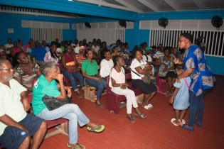 Minister within the Ministry of Communities, with responsibility for Housing, Hon. Annette Ferguson making a point during the community meeting.