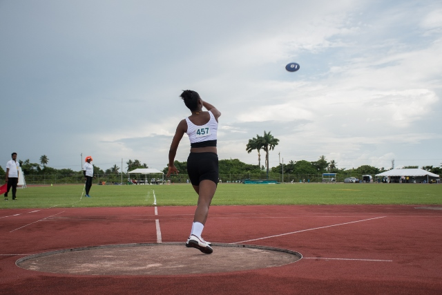 One of the U18 discus athletes launches her disc into the air.
