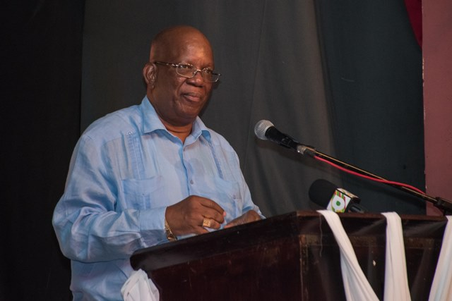 Minister of Finance, Hon. Winston Jordan addressing graduates of the latest Basic Needs Trust Fund and Merundoi audiovisual skills training project, at the Theater Guild Playhouse.