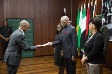 His Excellency, President David Granger accepting the letter of credence from High Commissioner for Jamaica, Arthur H.W. Williams.