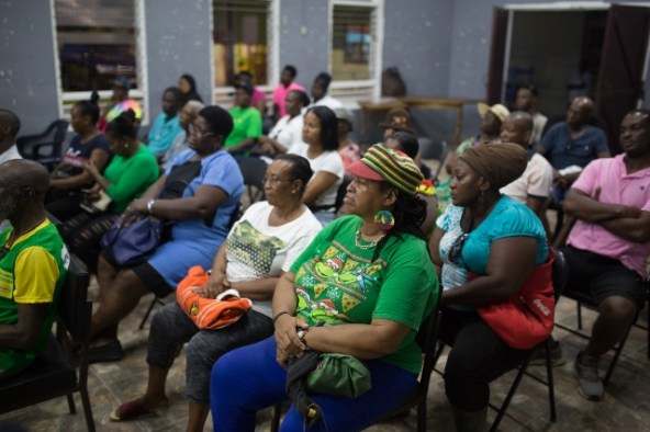 Attorney General and Minister of Legal Affairs, Hon. Basil Williams SC., speaking with residents of Mocha Arcadia during a community meeting.