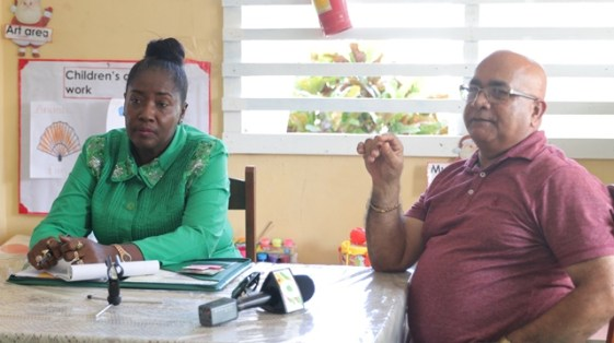 Minister within the Ministry of Agriculture, with responsibility for Rural Affairs, Hon. Valerie Adams-Yearwood and Regional Executive Officer (REO), Dennis Jaikarran Snr. chatting with the residents of Riverstown.