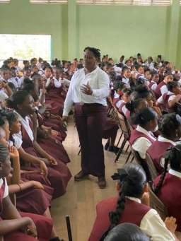 Minister within the Ministry of the Presidency, with responsibility for Youth Affairs, Hon. Simona Broomes during her address to the students of New Silver City Secondary School.