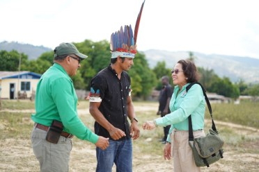 First Lady, Her Excellency, Sandra Granger being welcomed by Toshao of Monkey Mountain, Lincoln Singh in the presence of Minister of Indigenous Peoples' Affairs, Hon. Sydney Allicock.