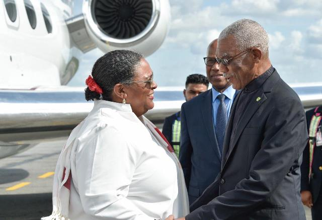 H.E. President David Granger greets Barbados Prime Minister Hon. Mia Mottley on her arrival at the Cheddi Jagan International Airport (CJIA)